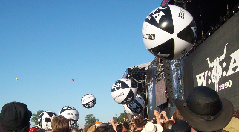 To occupy the waiting fans they sent in giant beach balls that are soon ripped to shreds...